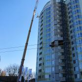 Dismantling of the tower crane in Kyiv (Liebherr LTM 1200)